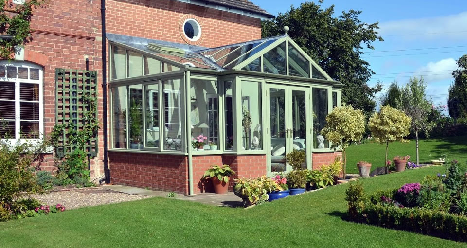 Solid timber and red brick conservatory